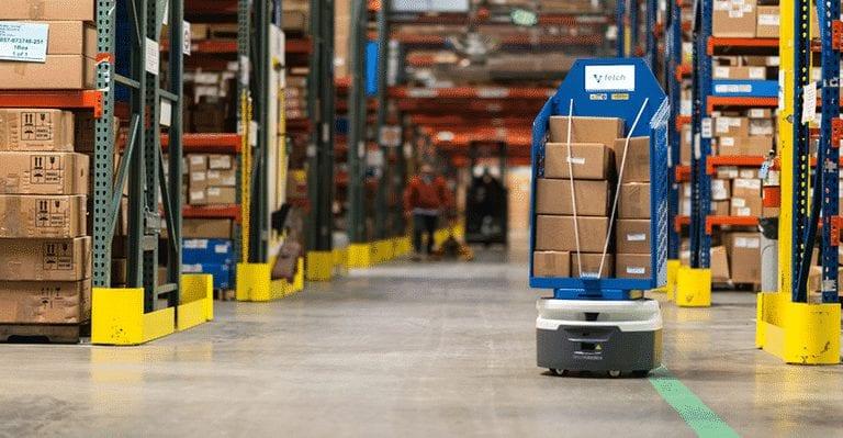 Robot moves through warehouse