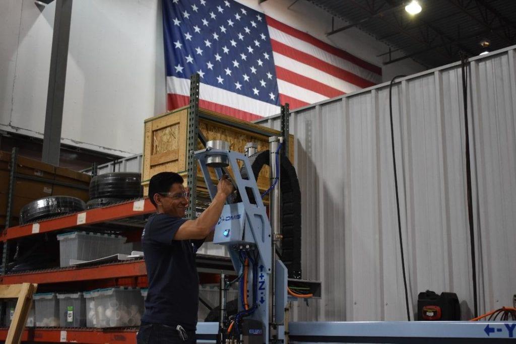 dms cnc technician building machine
