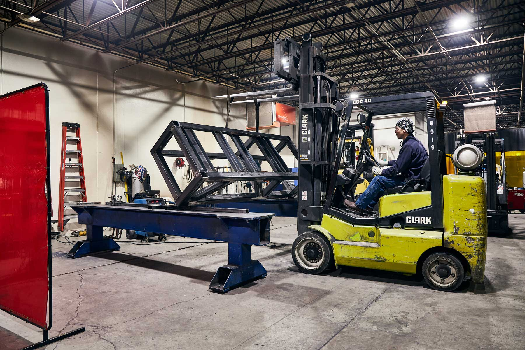 Man operating forklift on DMS floor